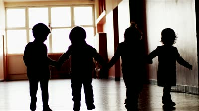 stock-footage--kids-walk-together-in-school-in-slow-motion-silhouettes