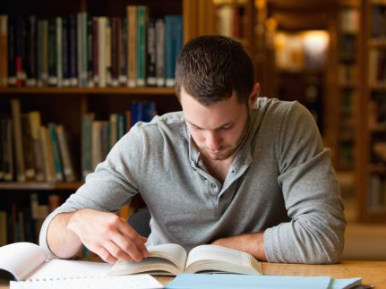man-studying-at-the-library