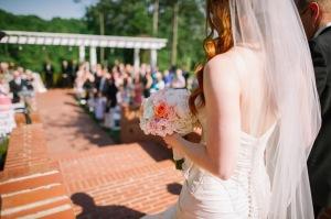 bride-walking-down-aisle-beautiful-bouquet-peach-ivory-mint-green