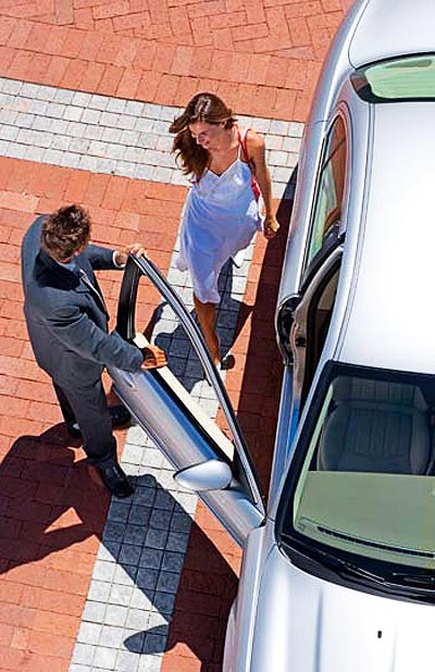 High angle view of man opening car door for woman