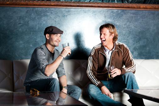Two men at a bar