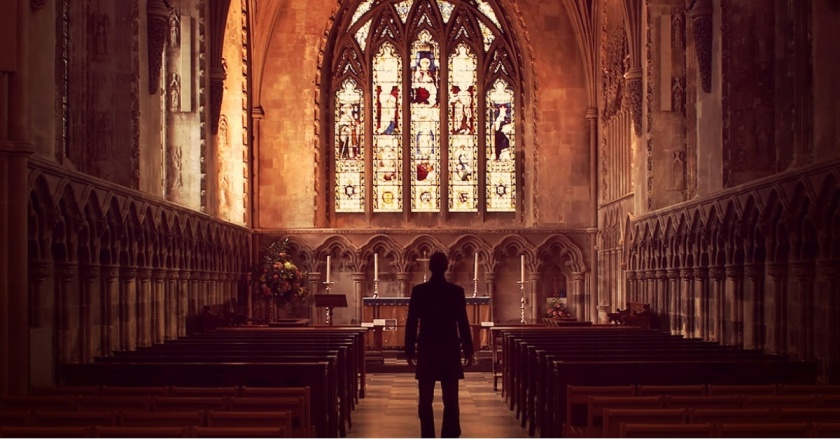 man-standing-church-aisle-silhouette-pastor-1200w-tn