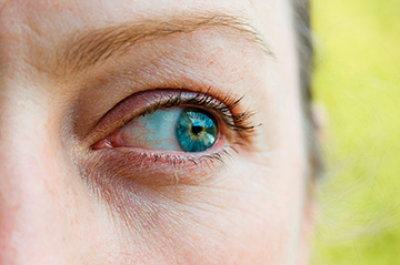 Close-up of woman looking out of the corner of her eye.